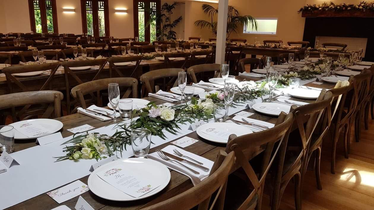 auckland wedding venue head wood tables with open fireplace