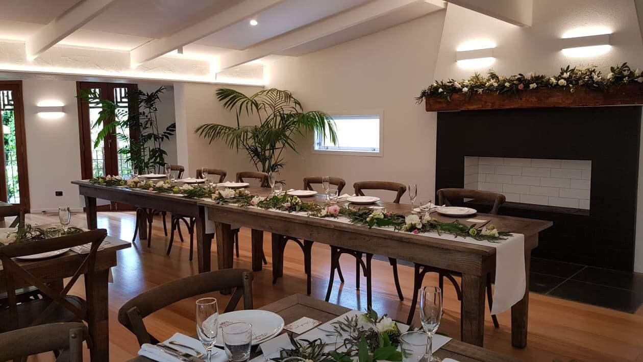 auckland wedding venue head table with open fireplace