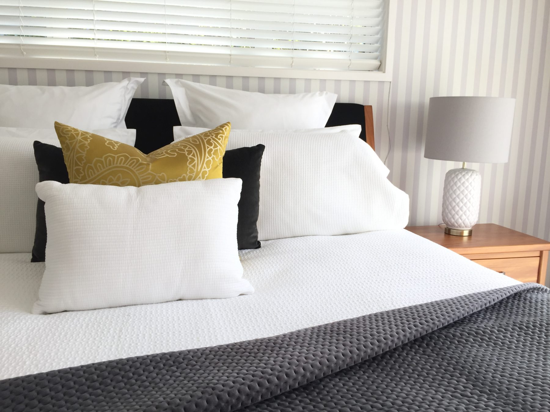 mustard yellow and charcoal grey master bedroom bedding