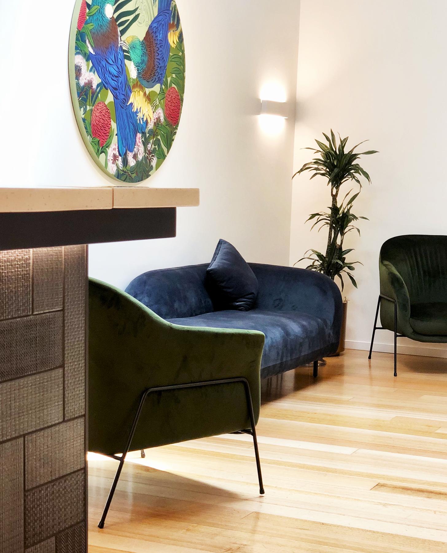 luxury wedding venue with custom flox wall art, velvet chaise and texture black tiles