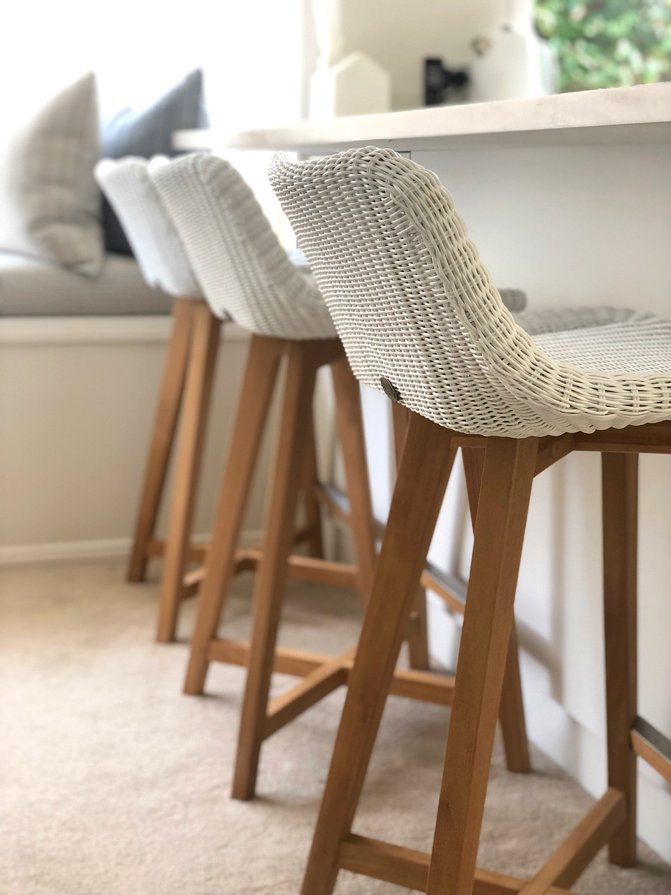 modern white and wood barstools at a kitchen breakfast bar