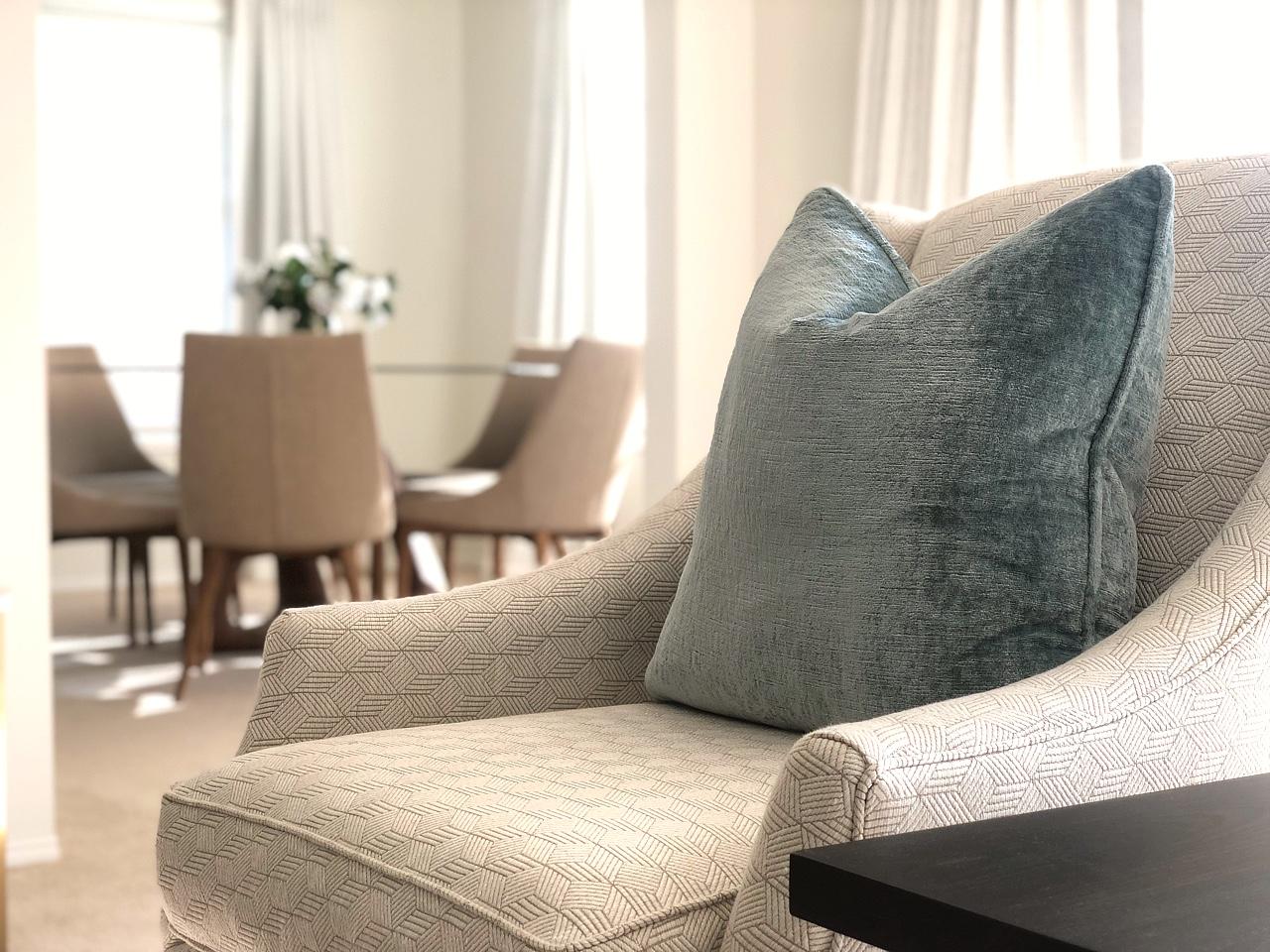custom made modern armchair with blue velvet cushion