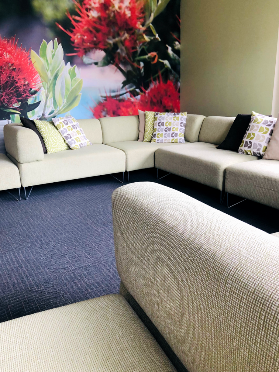 ronald mcdonald house casual seating area with pohutakawa wallpaper