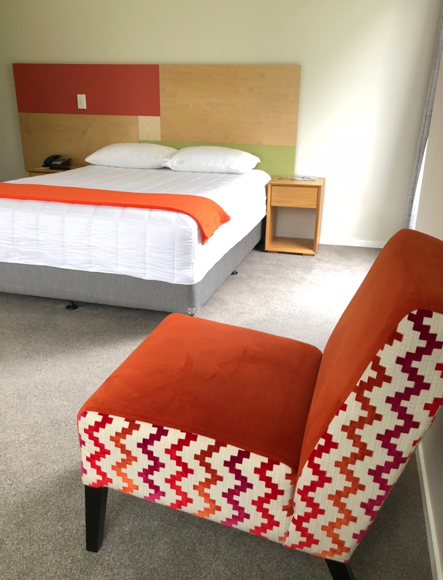 ronald mcdonald house family apartment setup with orange chair