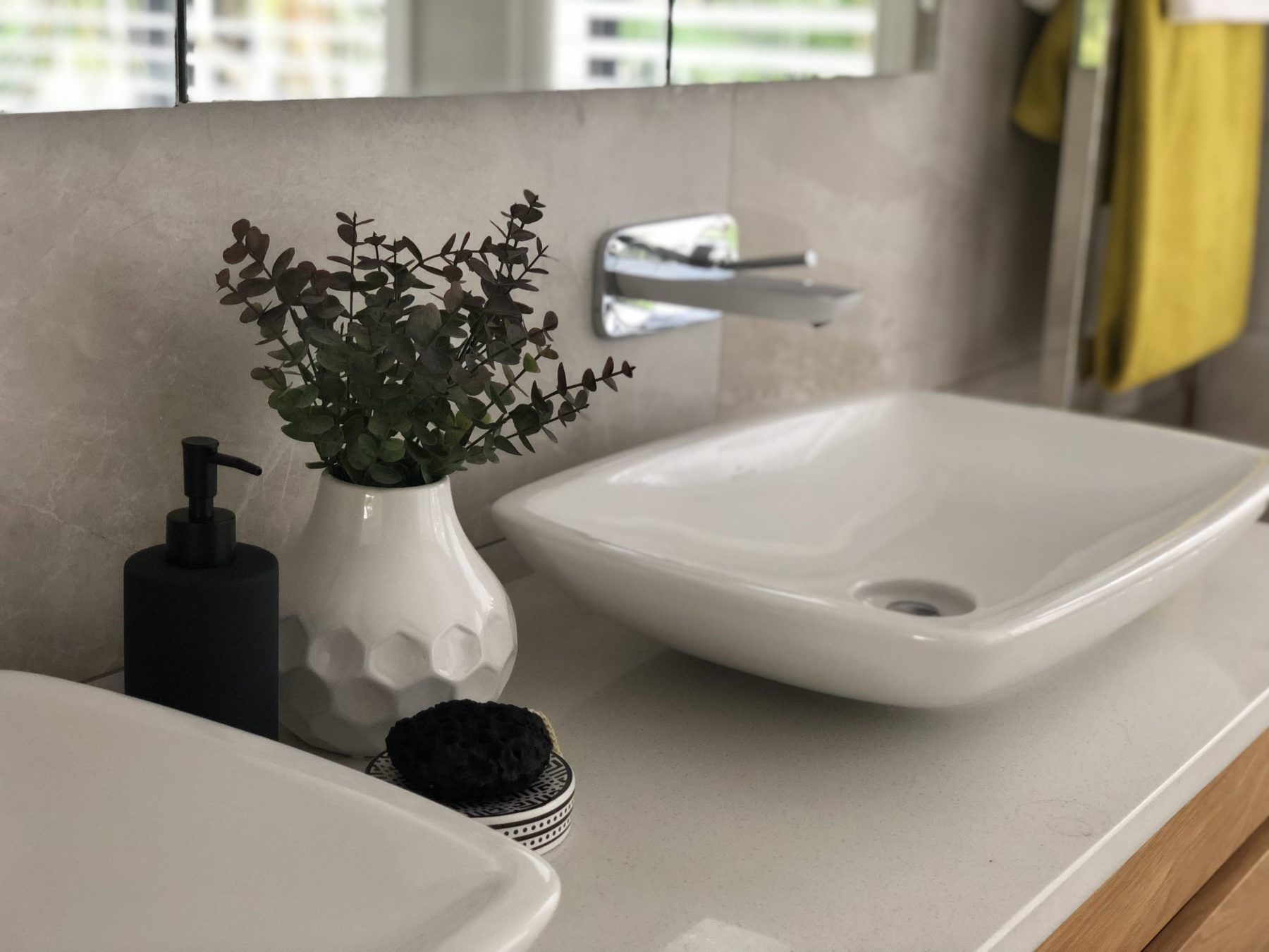 modern bathroom styling with monochrome accessories and statement yellow towels