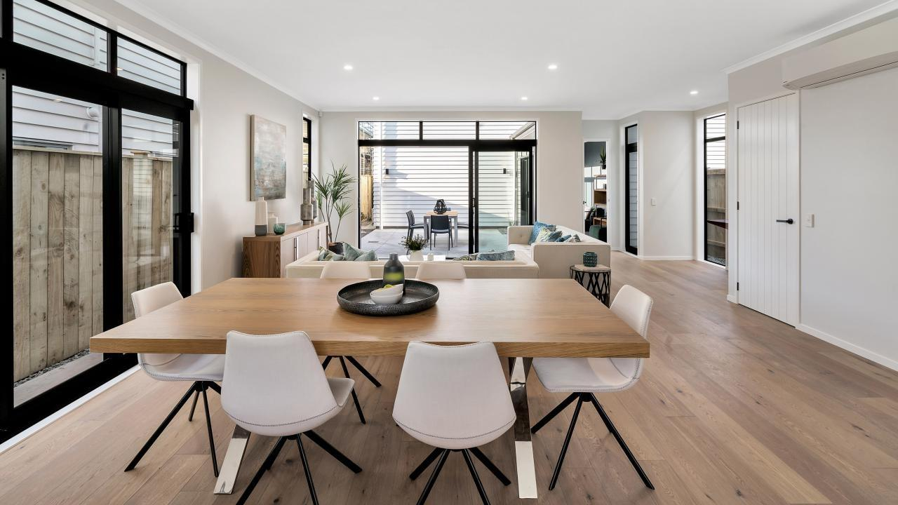 modern dining room setting with wood floors at new build home in hobsonville