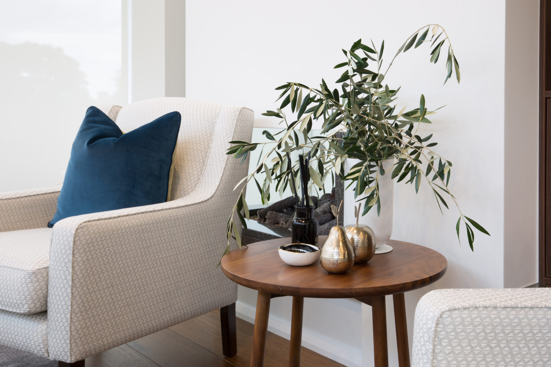contemporary seating area with relaxed seating and side table styling with plants