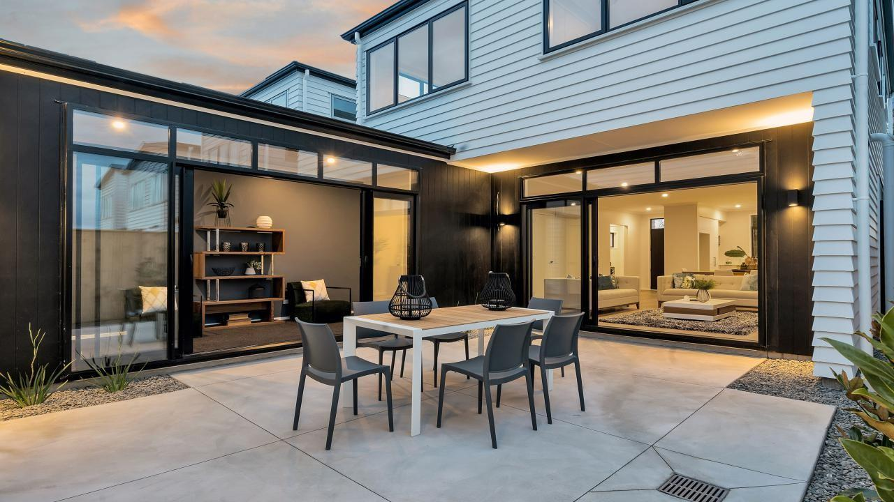 modern outdoor dining setting with table and chairs at a new build family home in hobsonville