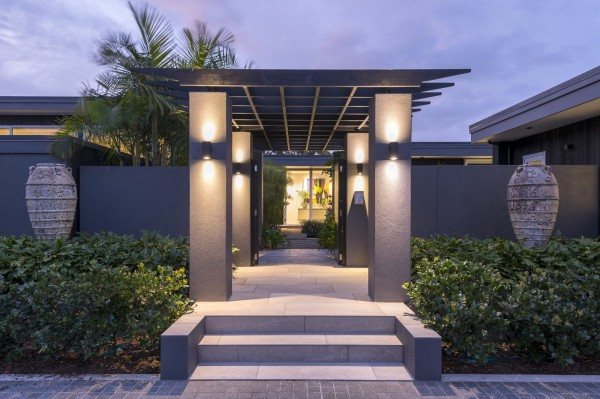 dark exterior paint colours on modern home with entrance pergola and modern lighting
