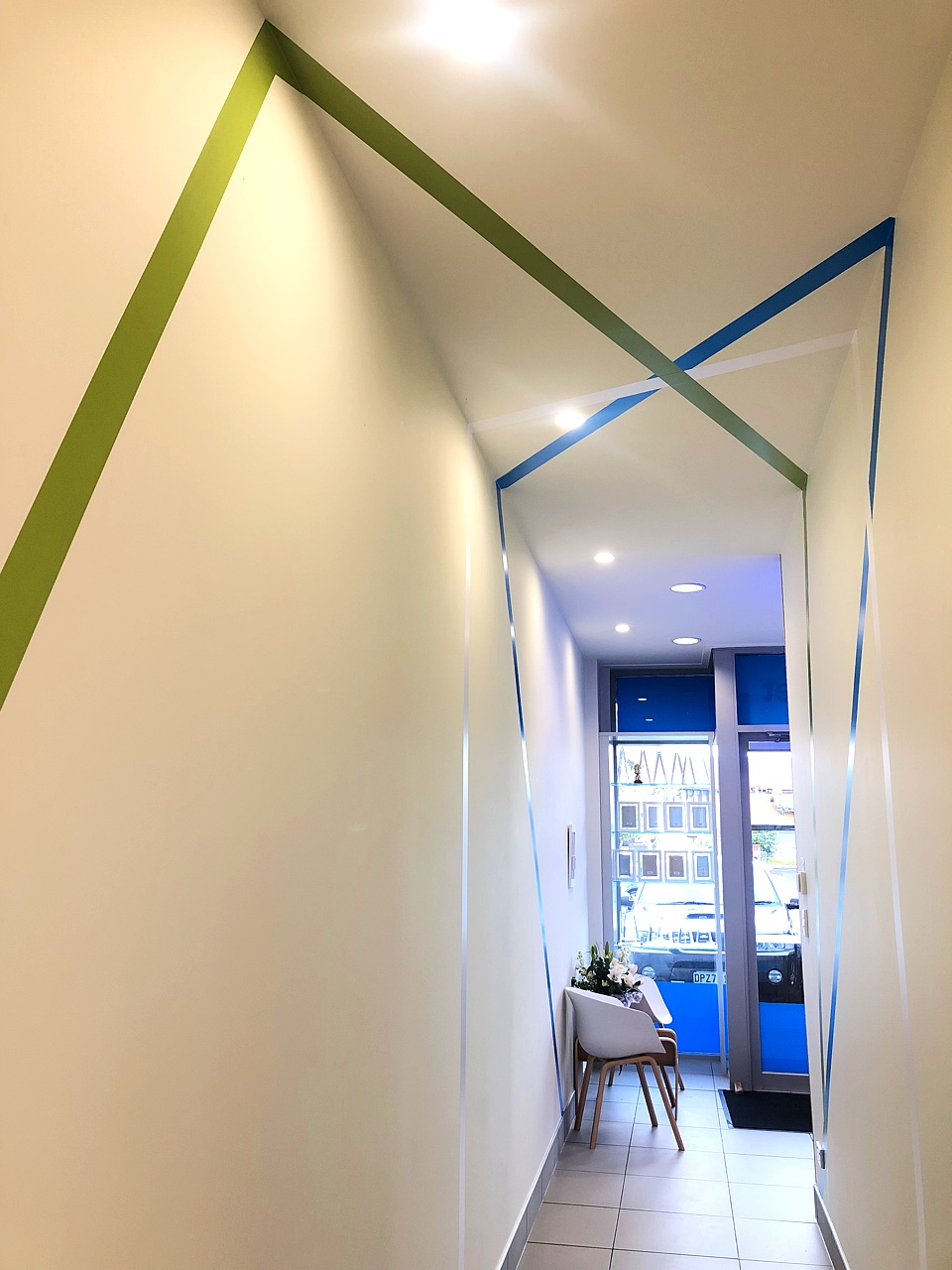 modern office hallway blue with blue and green stripe wall decals