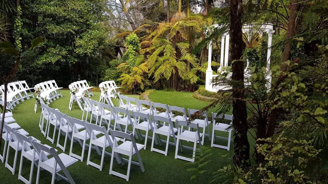 auckland outdoor wedding venue outdoor ceremony with white chairs