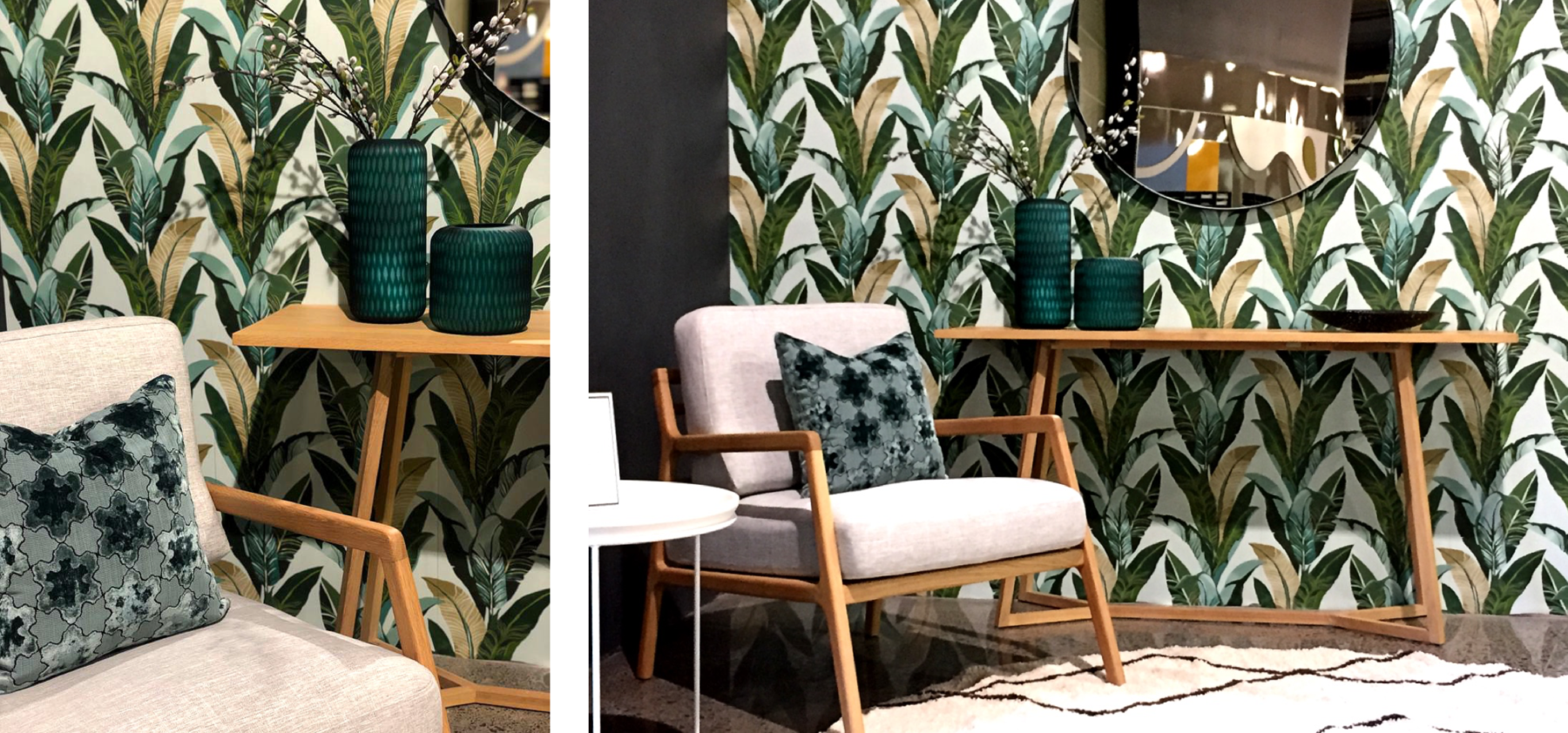 modern scandi grey chair with wood arms, wood console table, round black mirror and banana leaf wallpaper