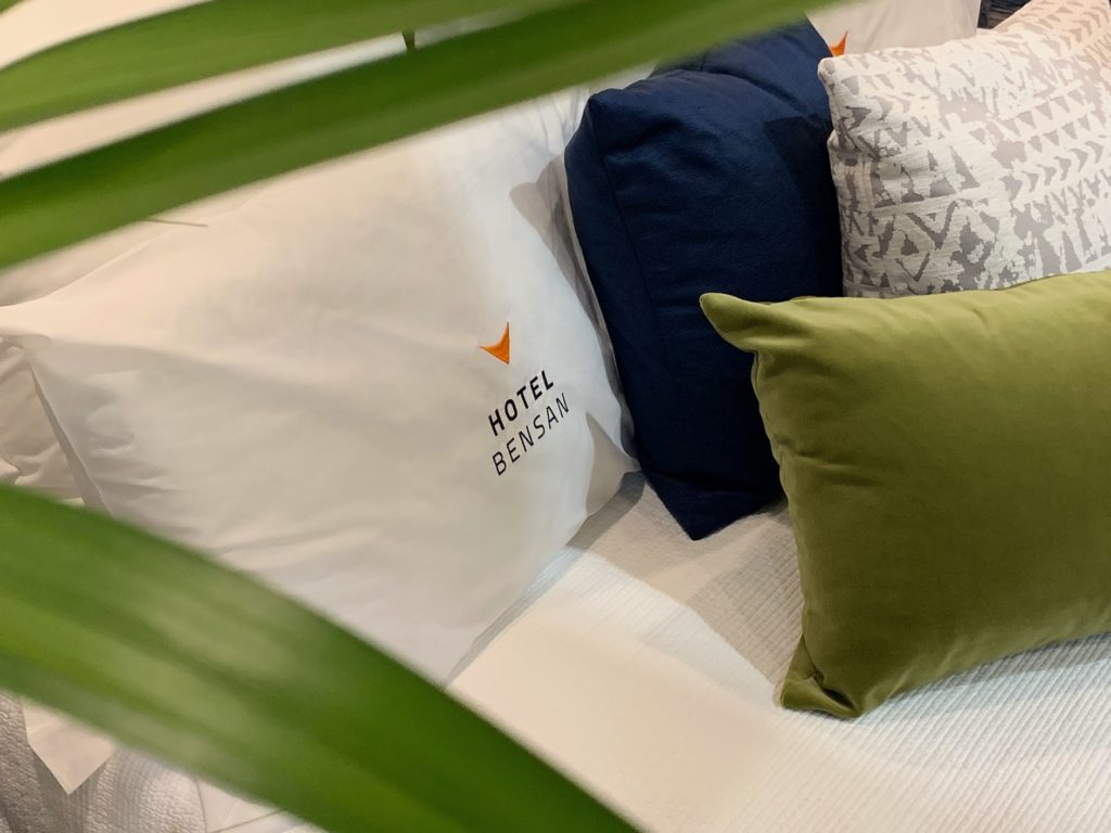 close up of hotel bed with cushions