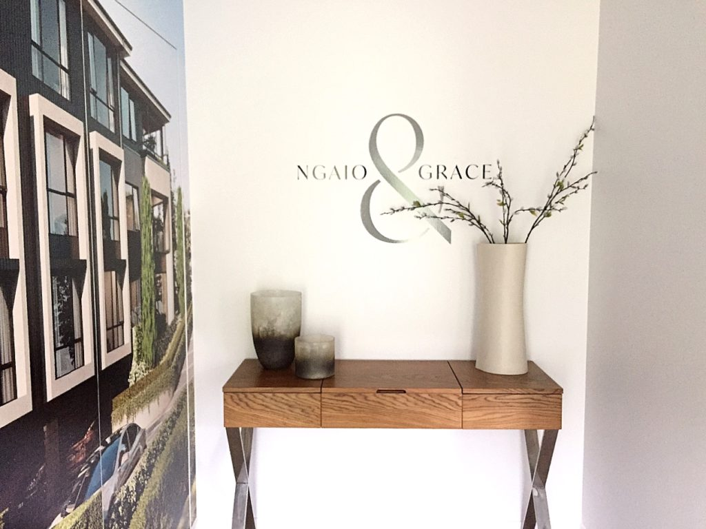 wood hallway console table styled with plant and vases