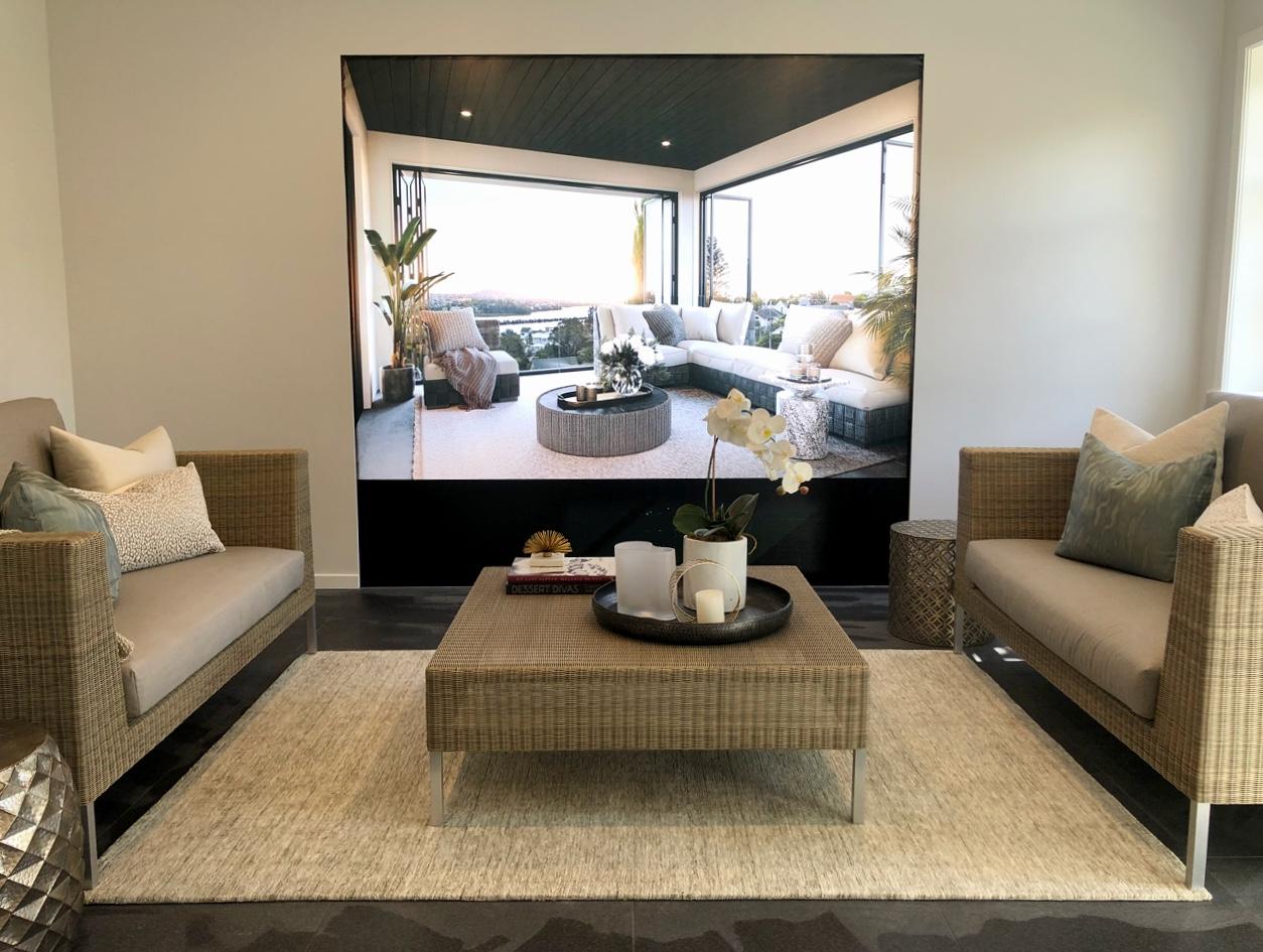 casual luxury lounge setup with slate tile floors and rattan furniture
