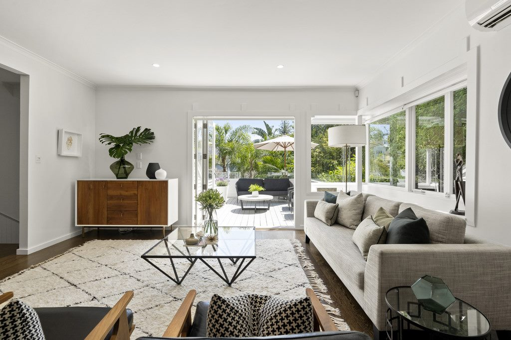 modern eclectic living room with glass coffee table and grey sofa