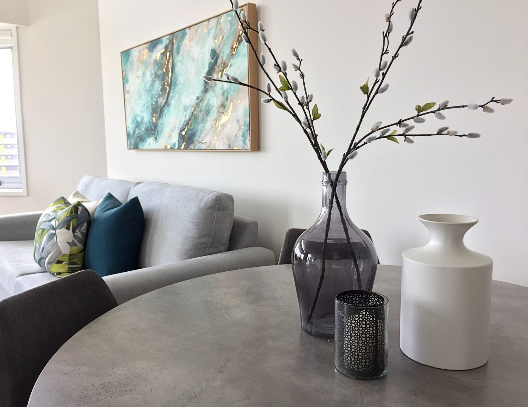 dining table styling and grey sofa