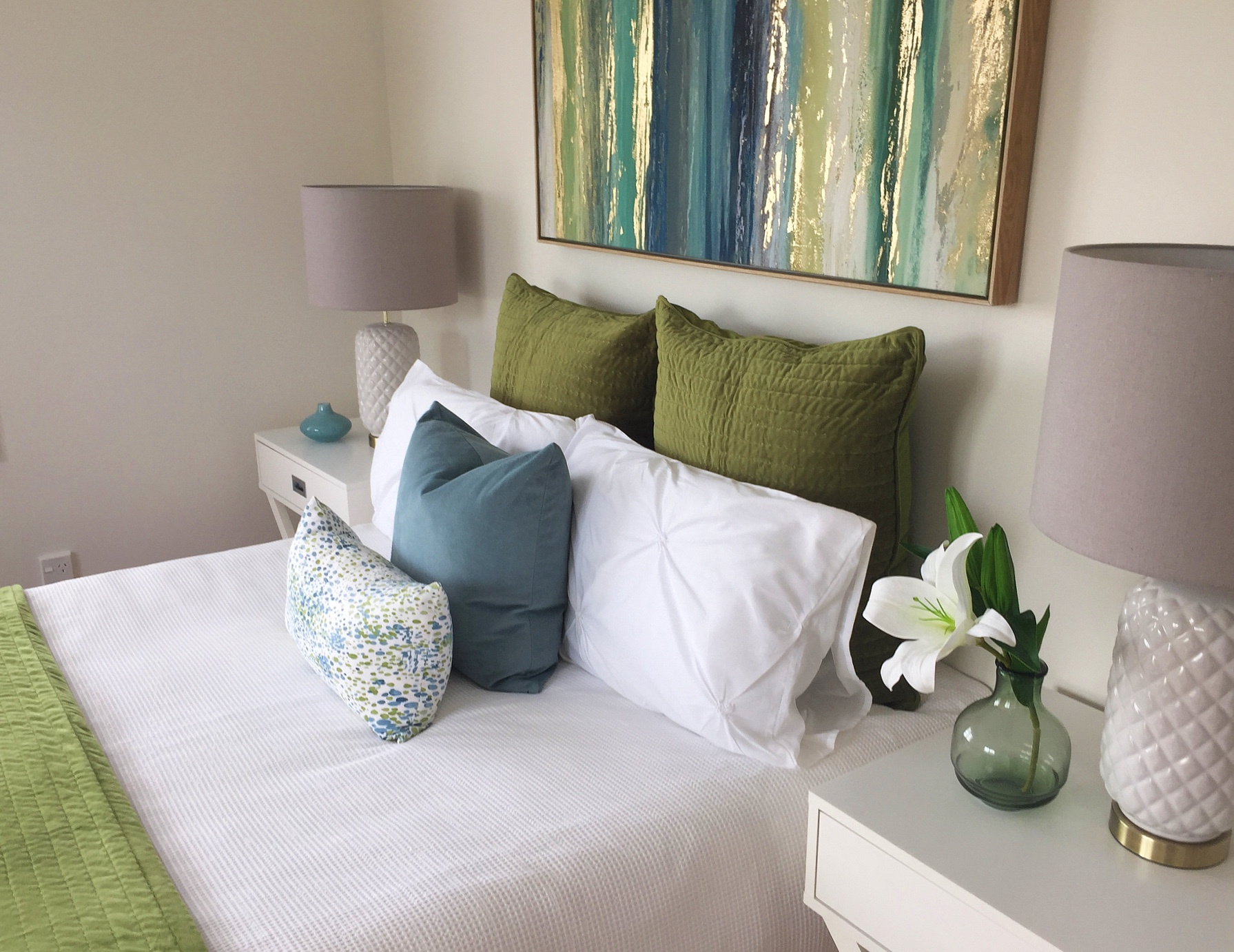 Blue and green bedroom with art