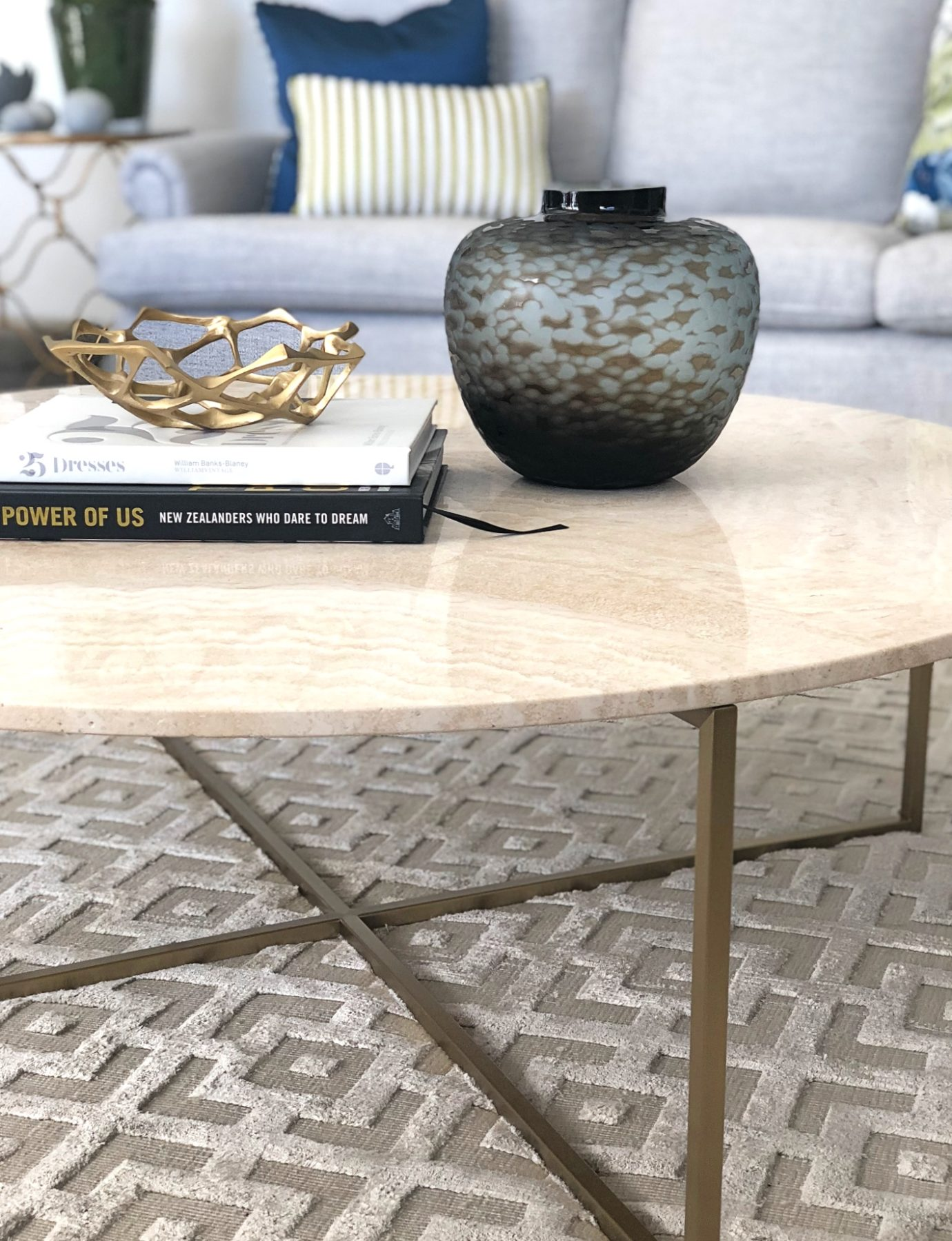 close up of marble coffee table styling with textured rug