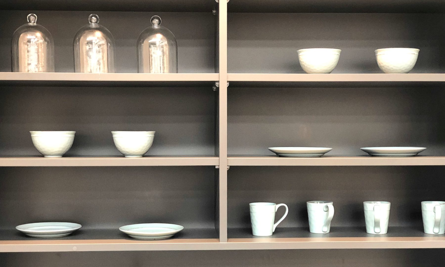 styled kitchen shelves with cups and bowls