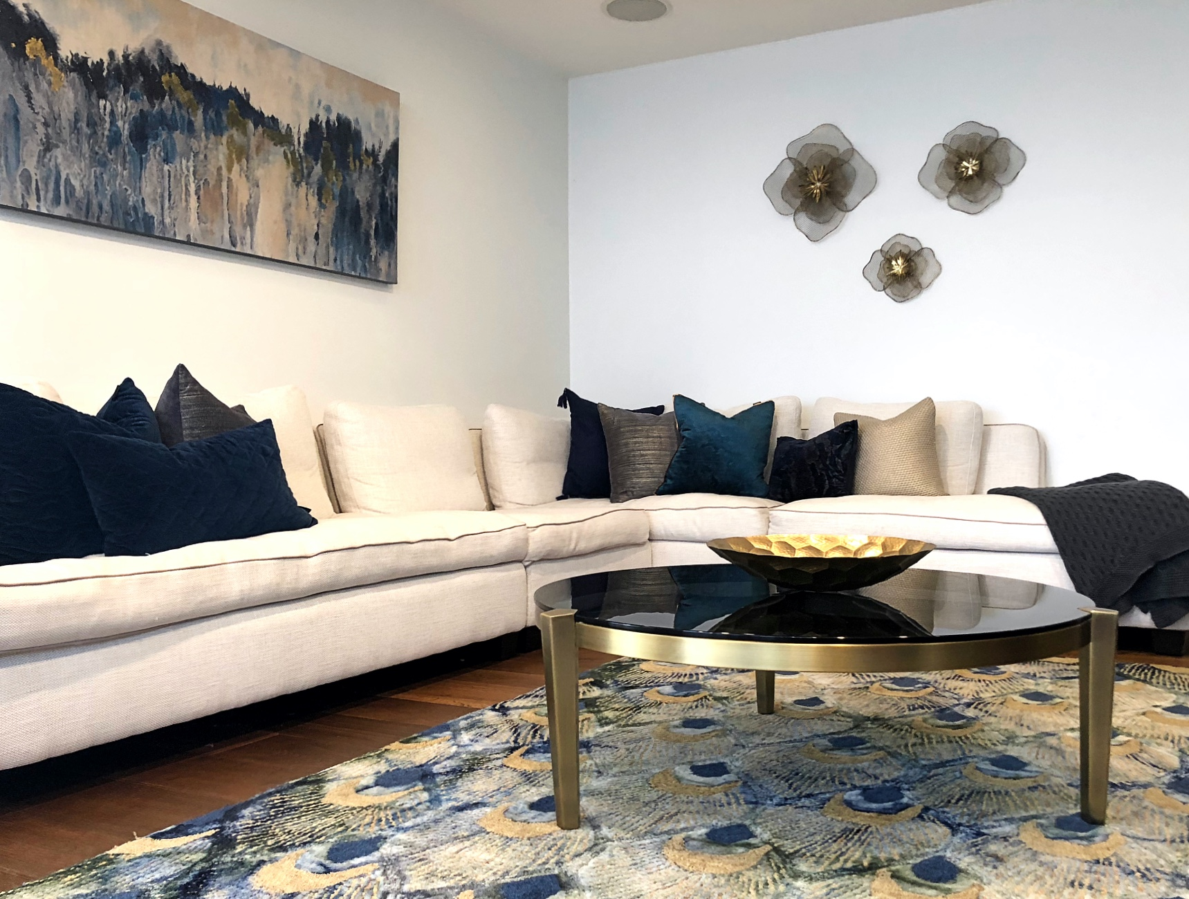 blue and gold luxury living room with peacock rug