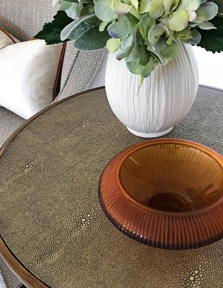modern side table styling with orange vase