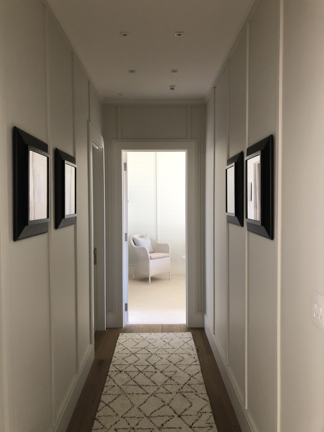 modern panelled hallway with runner