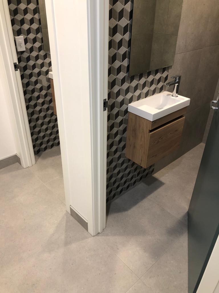 small bathroom with zigzag patter tiles