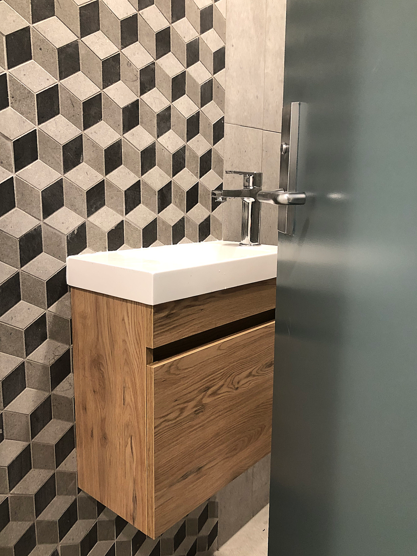 modern small bathroom with wallhung vanity and geometric tiles