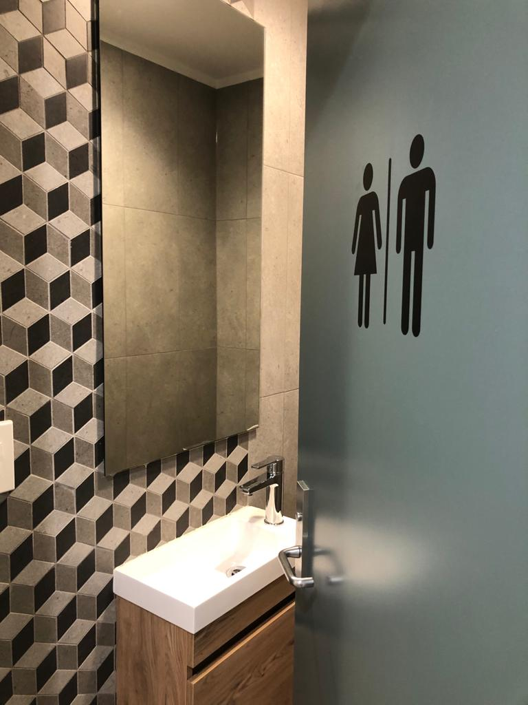 small bathroom with vanity and geometric tiles