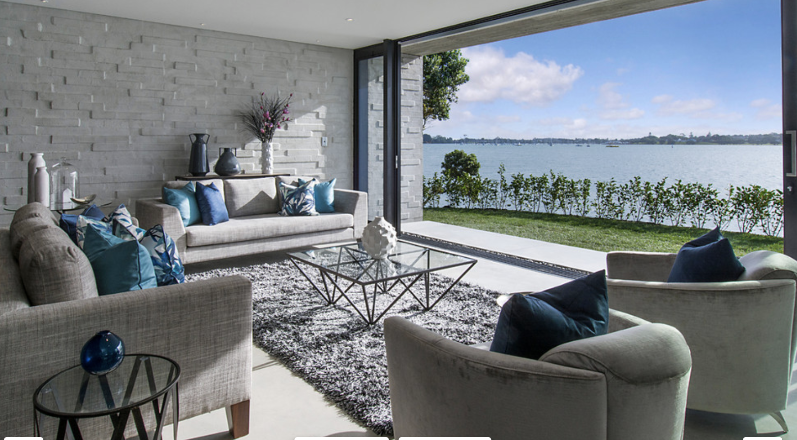 modern blue and grey living room with ocean view
