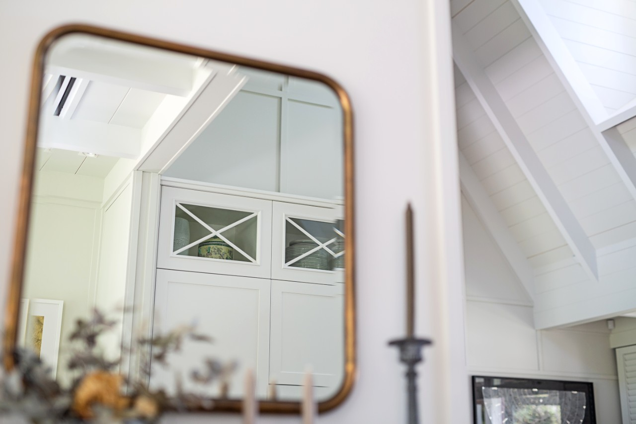 mirror reflection of hamptons style cabinetry detail