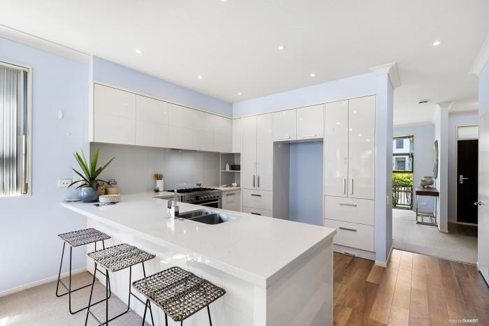 modern white kitchen with white light blue walls