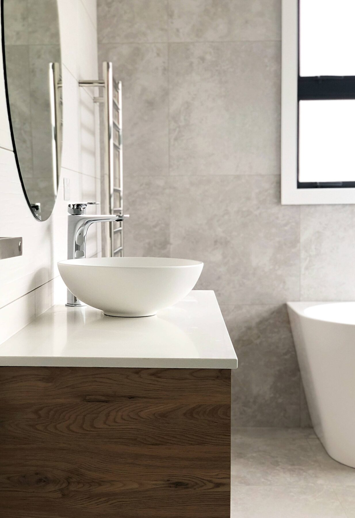 modern clean bathroom vanity design with grey concrete texture wall tiles and round surface mount basin