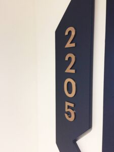 apartment number door sign with brushed brass lewttering