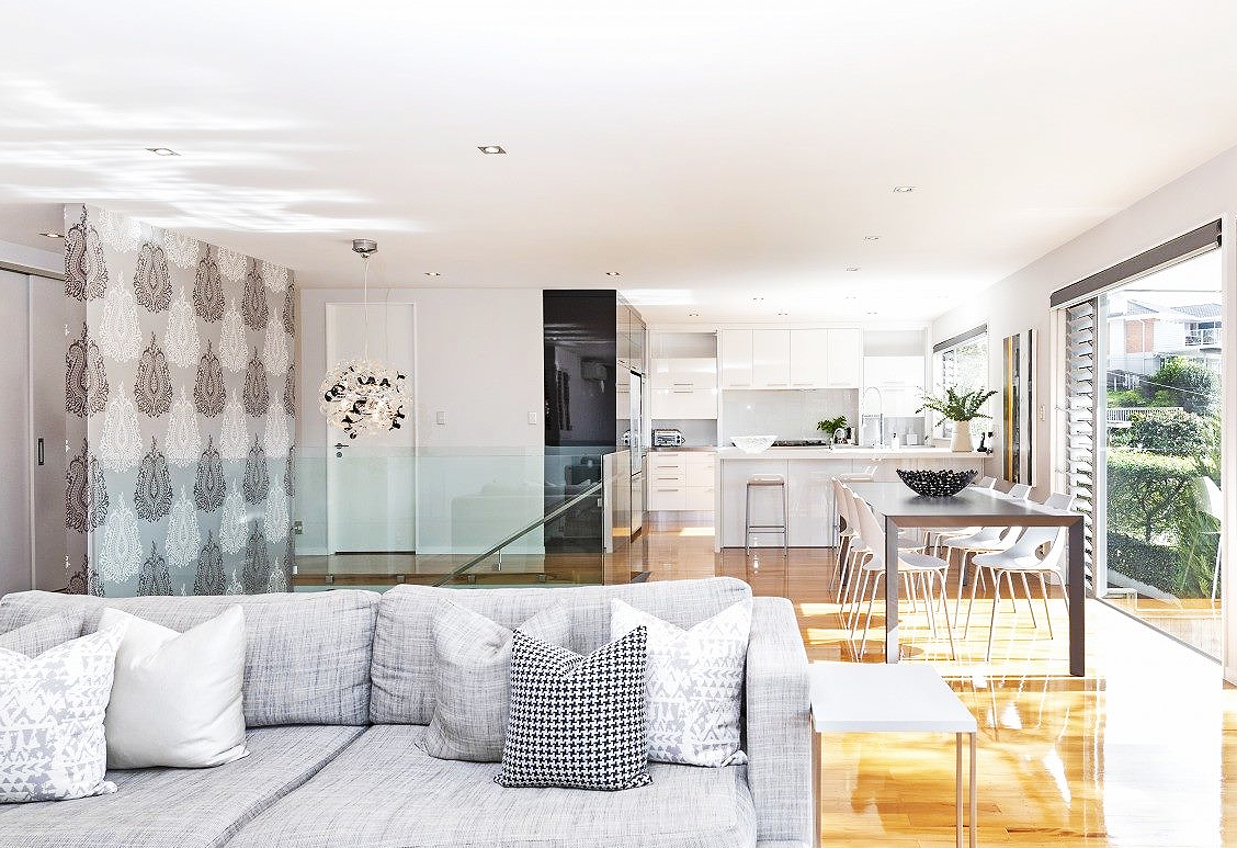 modern light filled home with wood floors, monochrome colour scheme