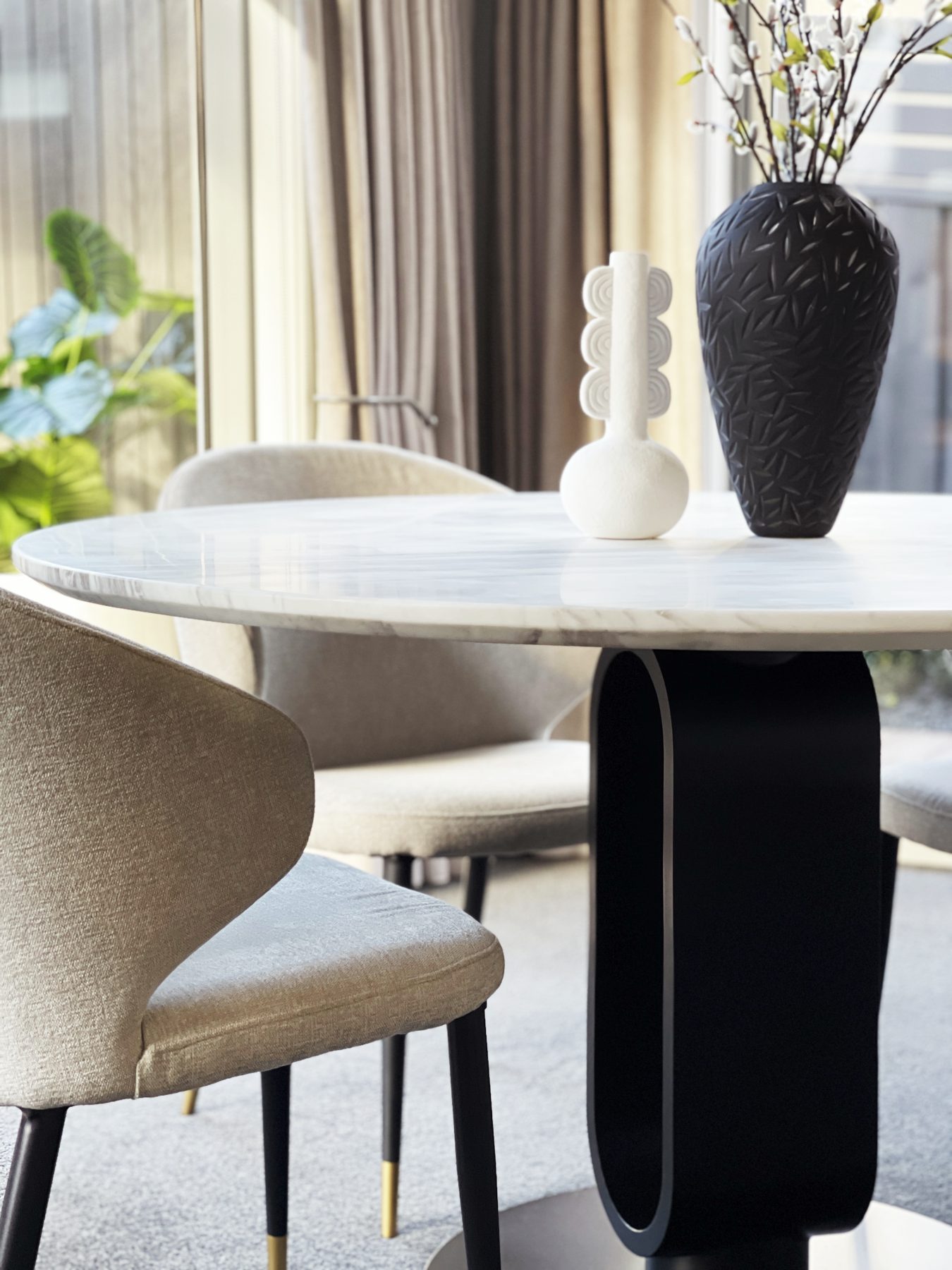 Luxury contemporary dining table and chairs with textured fabric, marble top and brushed brass highlights
