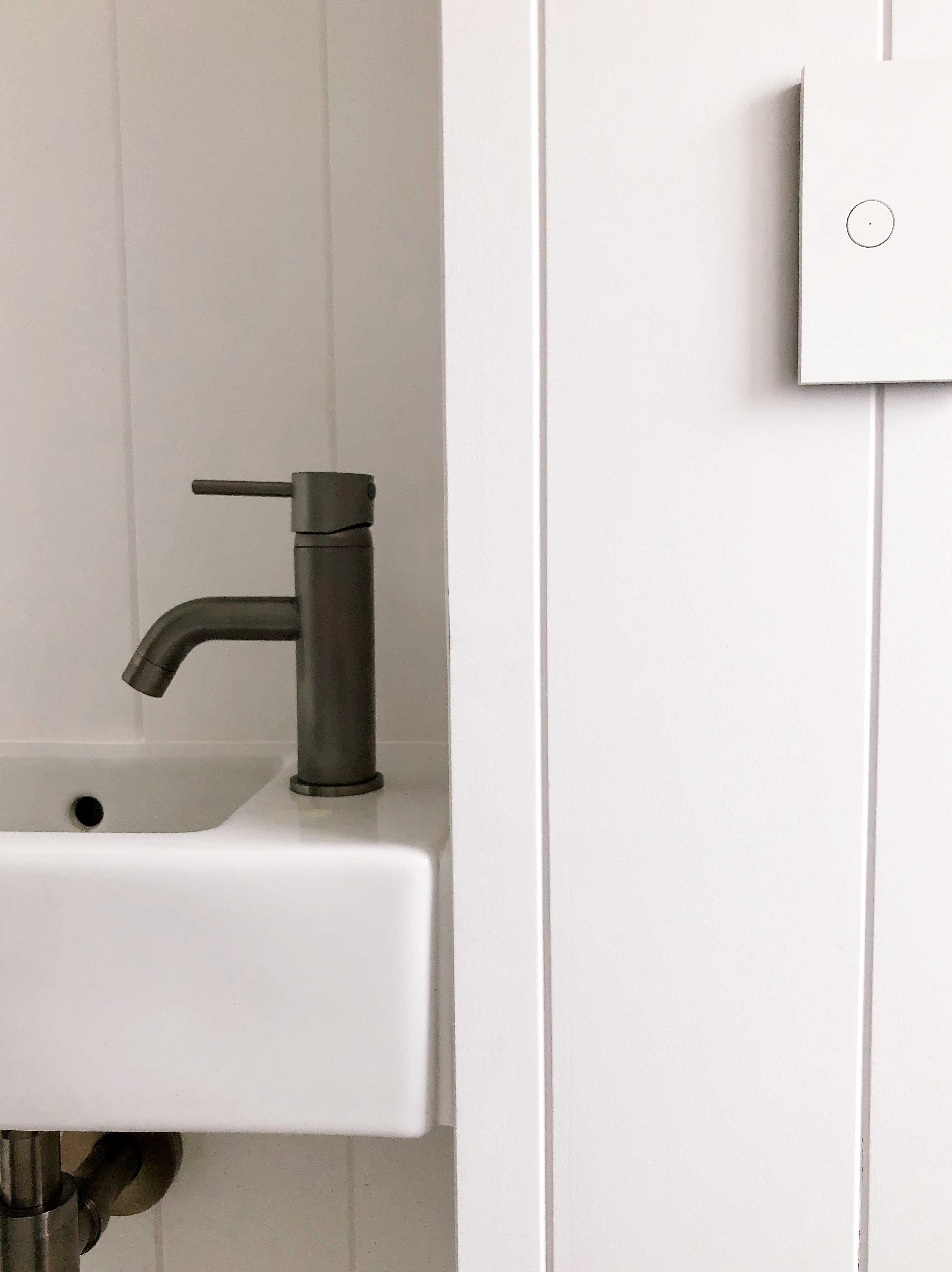 closeup of bathroom with modern tongue and groove panelling