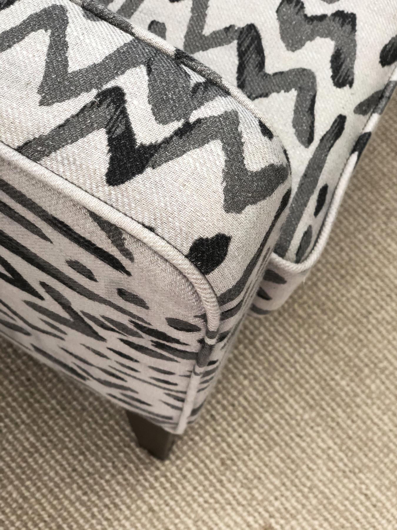 closeup of designer armchair on sisal carpet
