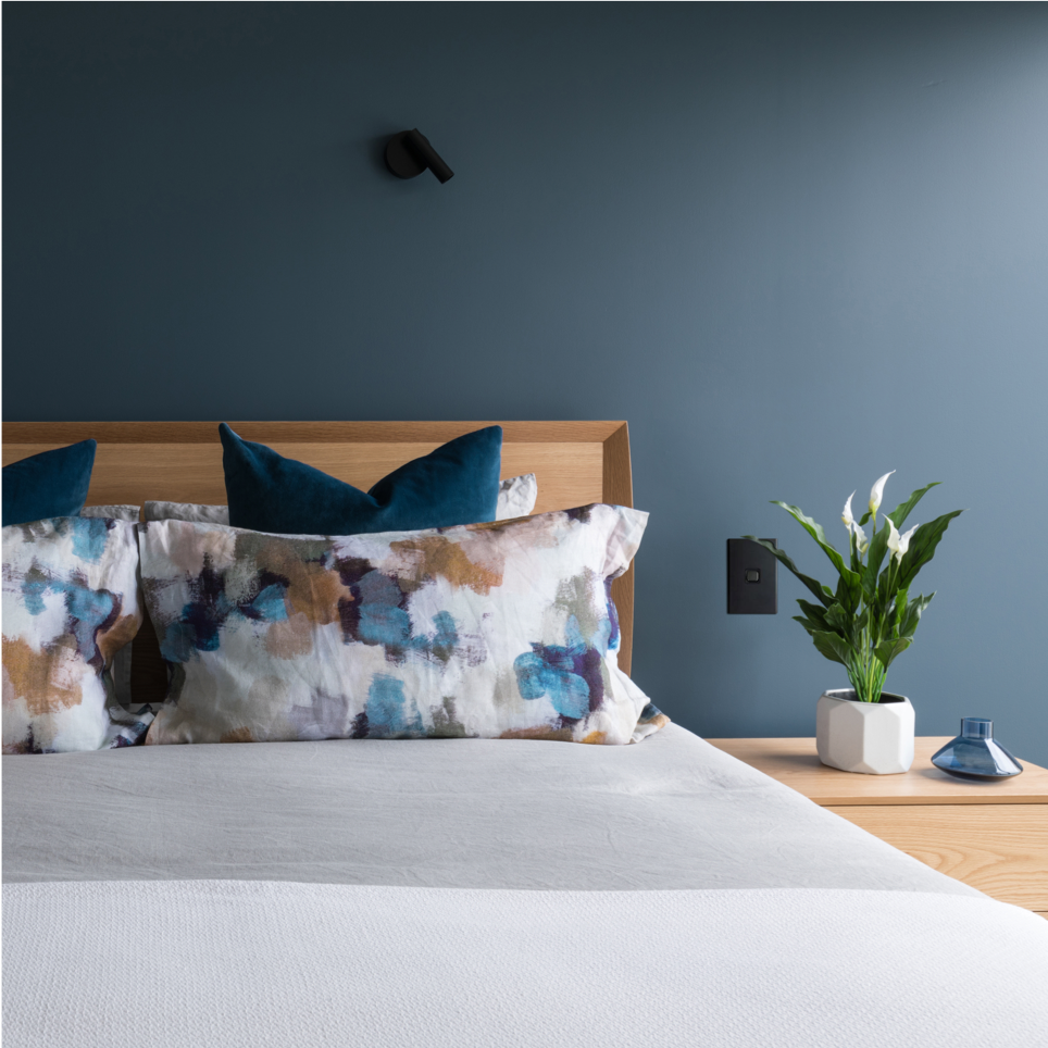 restful modern bedroom with blue feature wall
